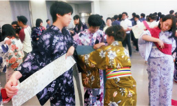 High school students from China experiencing wearing Yukata, summer cotton Kimono, at Iwata High School (Oita Prefecture)