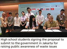 High school students signing the proposal to submit to the government in Jakarta for             raising public awareness of waste issues